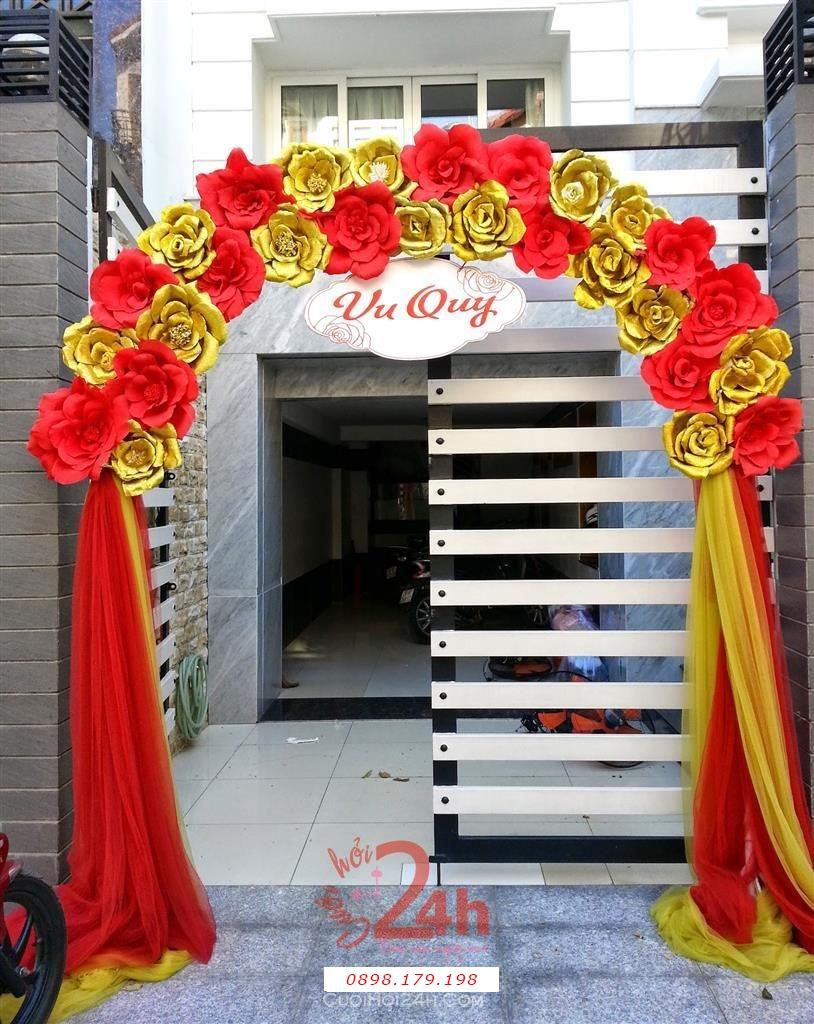 Dịch vụ cưới hỏi 24h trọn vẹn ngày vui chuyên trang trí nhà đám cưới hỏi và nhà hàng tiệc cưới | Cổng hoa giấy màu đỏ vàng ấn tượng